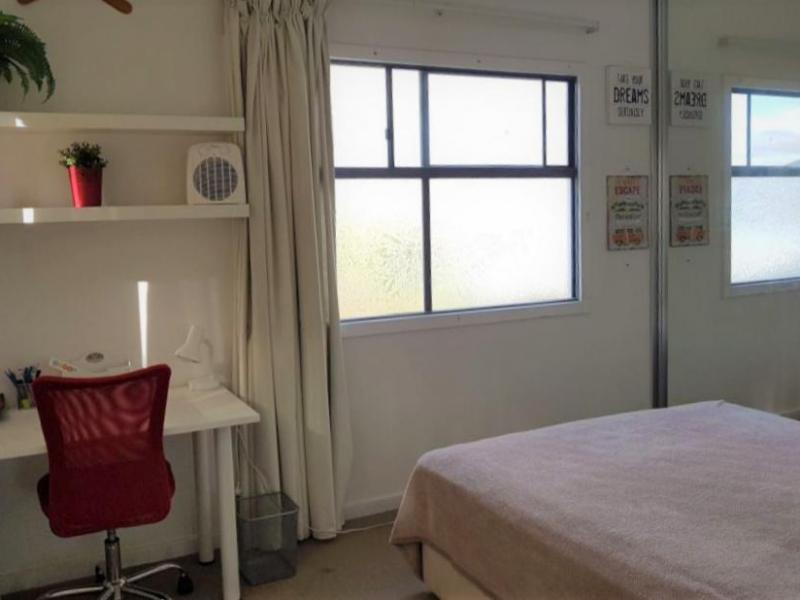 Spacious and quiet bedroom with a comfortable queen bed and large wardrobes