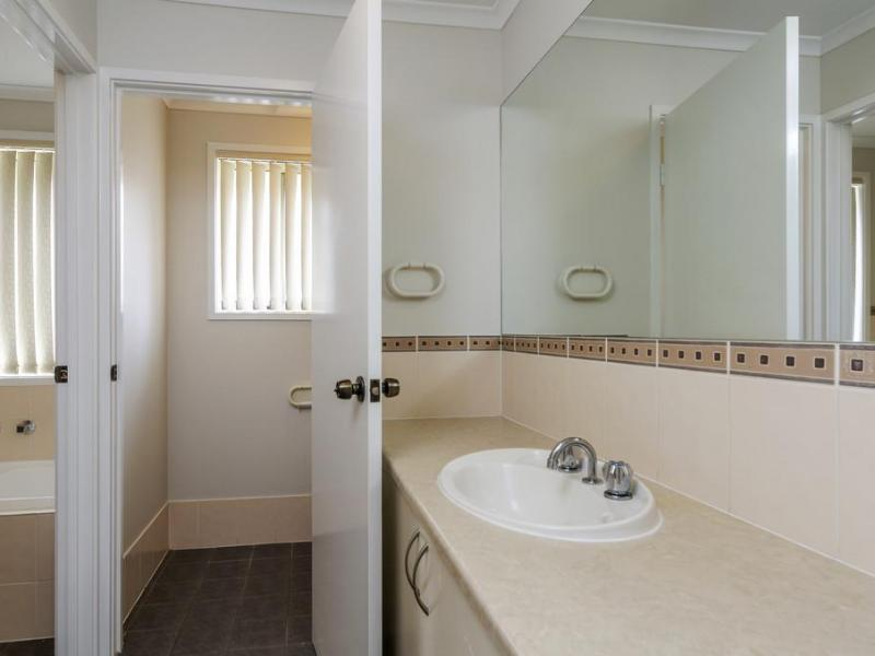 Upstairs washroom, bath, and toilet