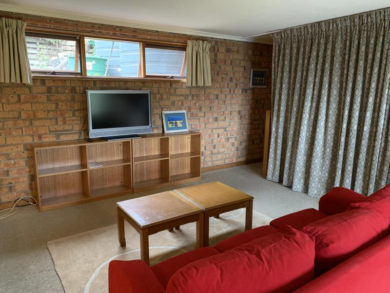 Own TV, couch, storage shelves for a comfortable, self contained homestay experience.