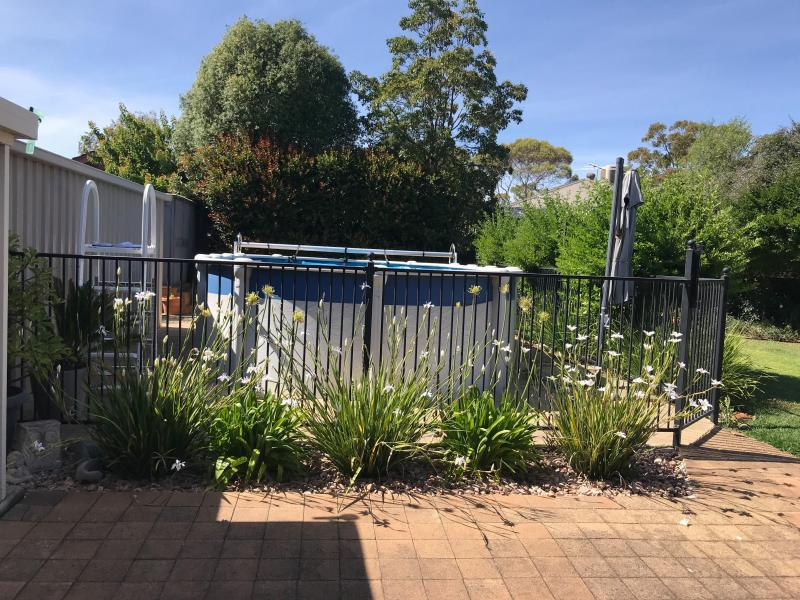 Large backyard: has above ground pool, patio & lawn area