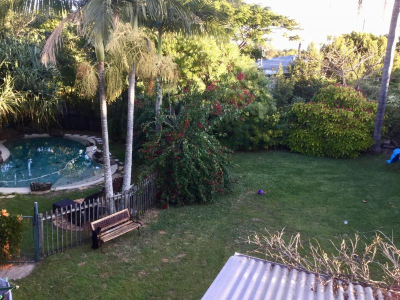 garden and pool from upstairs balcony off the bedroom