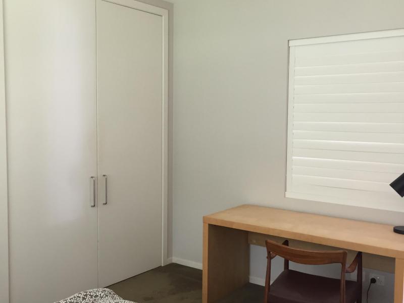 Desk, shutters look out onto garden, ample wardrobe space