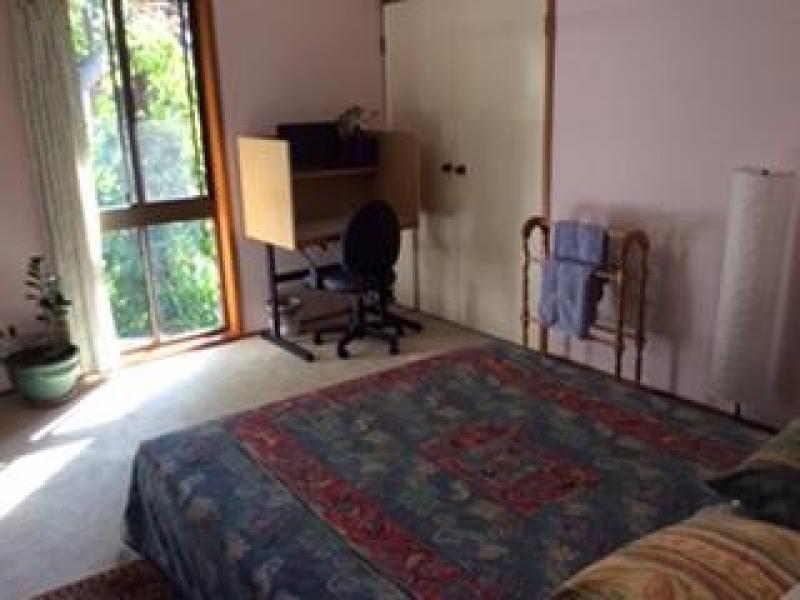 Room with queen bed, desk, aircon, chest of drawers, cupboard and close to bathroom including bath and shower