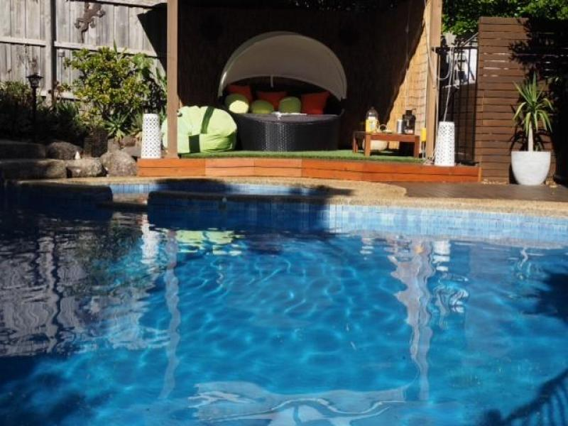 Outdoor solar heated swimming pool