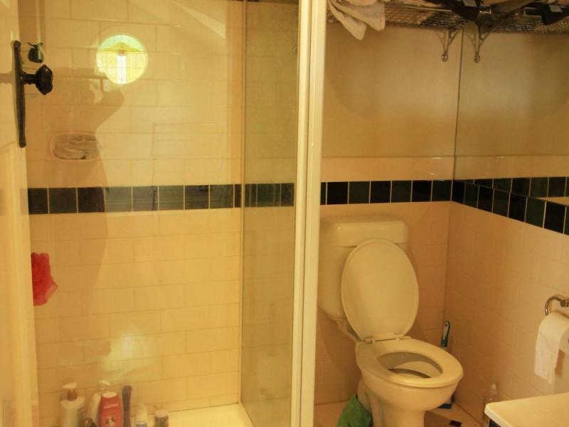 The upstairs bathroom has a shower toilet and vanity basin cupboard