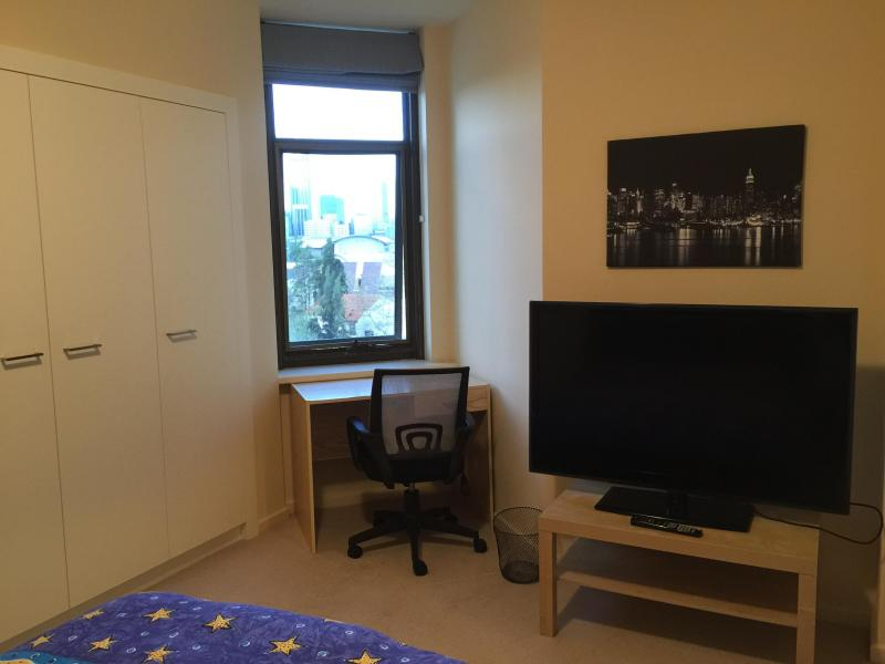 Bedroom 1, Queen Bed, TV, Fitted wardrobes, desk