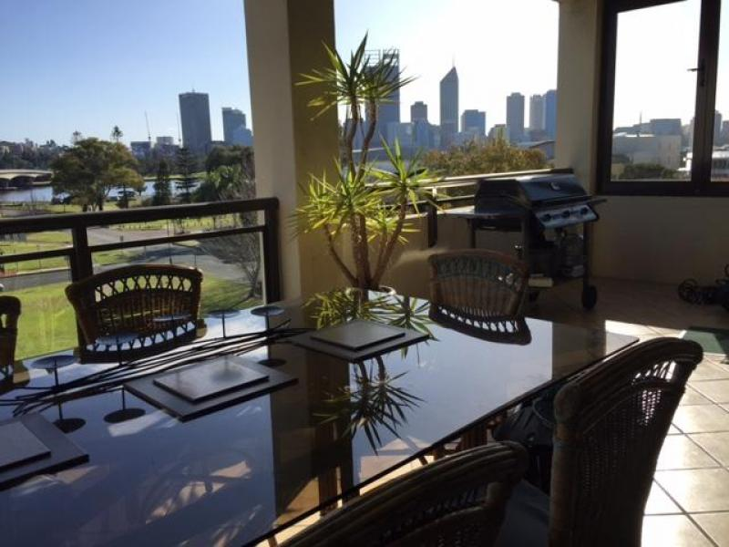 Large relaxing balcony overlooking the city