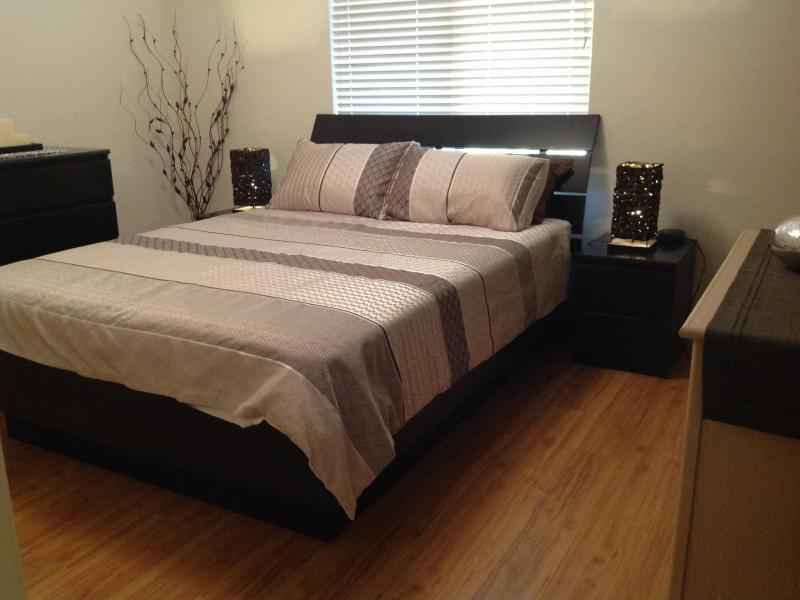 Large double bedroom. Modern furnishings including contemporary Queen size bed, chest of draws, storage cupboard & built in wardrobe with student desk if required.