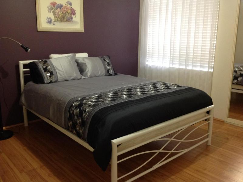 Our other large double bedroom. Modern furnishing including contemporary Queen size bed. Chest of draws, built in wardrobe with student desk if required