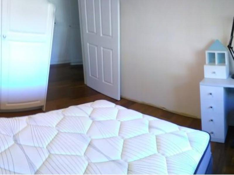 Single bedroom equipped with table lamp and study table, built-in wardrobe.