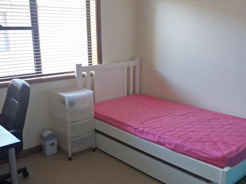 Room with bed, study desk, chair and a cupboard. Also include 4 large wardrobe for other items