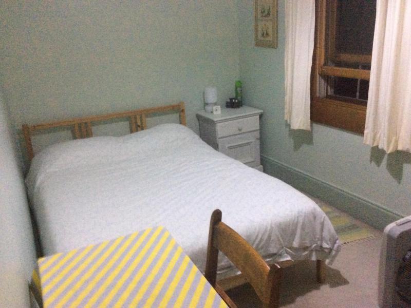 Bedroom.   Desk,desk lamp , fan
