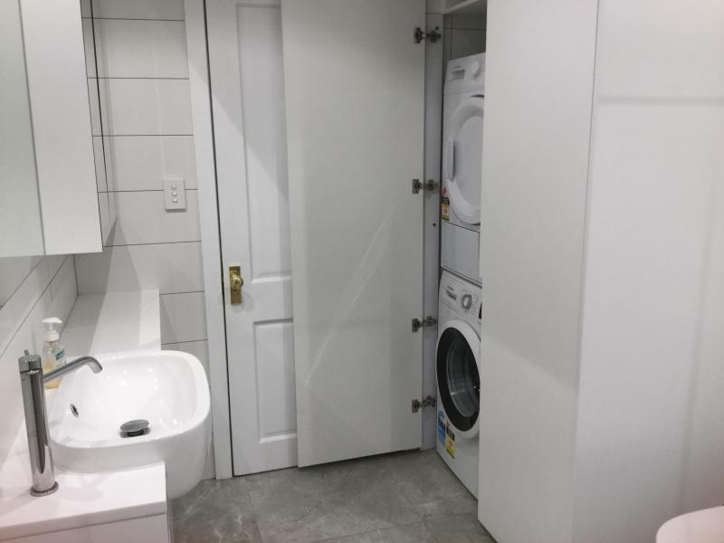 Separate guest laundry with dryer