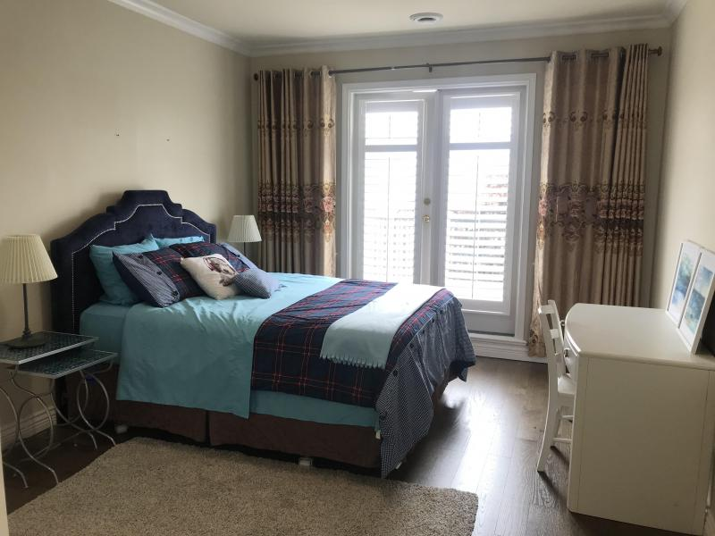 Blue Queen bed with ensuite,table,,nightstands, lamps ,one walking clothes set  $$450/W