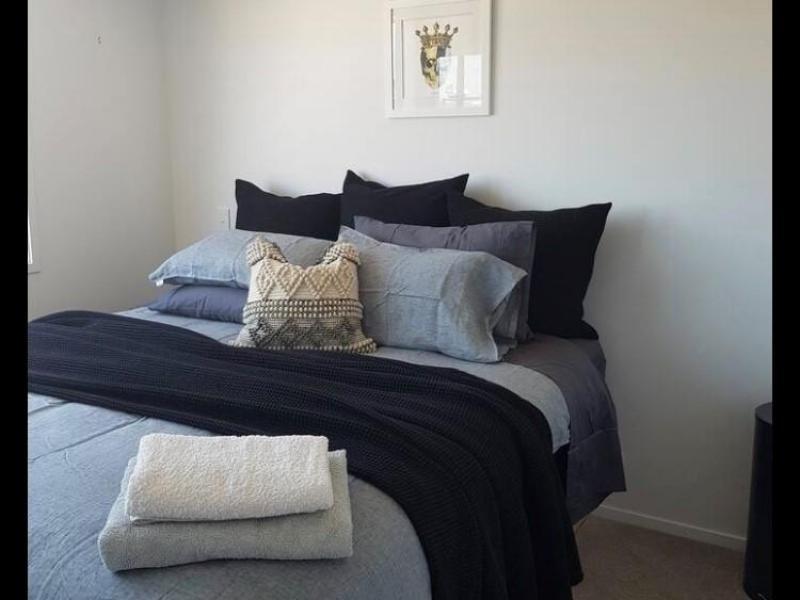 King bedroom, complete with flatscreen TV, double warbrobe, sea views