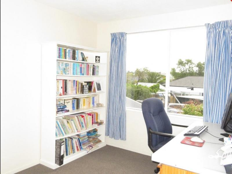 This study is now the smaller single room with a king single bed and tallboy.