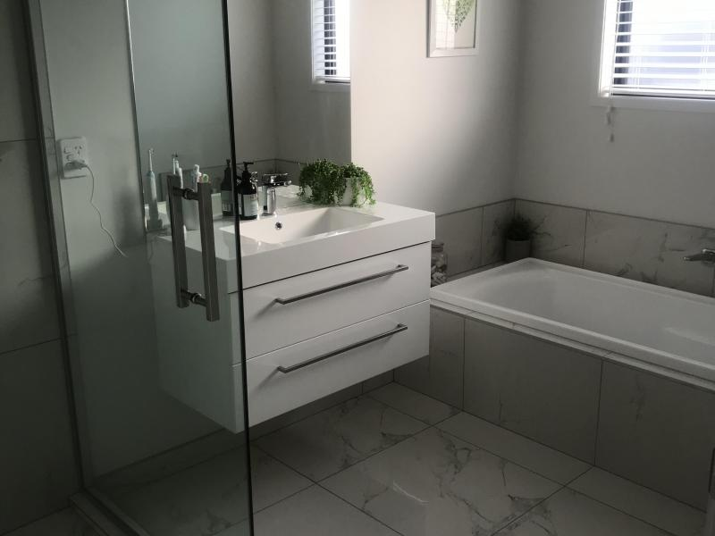 Bathroom next to room with shower and Bath